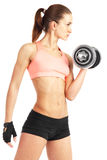 Fit woman with dumbbell - isolated over white background Stock Image