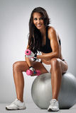 Fit woman with dumbbells Royalty Free Stock Photo