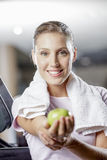 A fit woman eating an apple Royalty Free Stock Photo