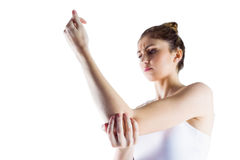 Fit woman with elbow injury Royalty Free Stock Images