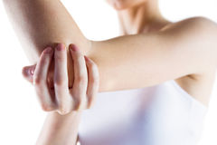 Fit woman with elbow injury Stock Image