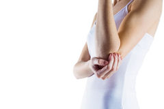 Fit woman with elbow injury Royalty Free Stock Photos