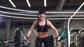 Fit woman execute exercise with exercise-machine Cable Crossover in gym. Portrait of woman exercising power cable crossover for chest muscles at gym stock footage