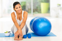 Fit woman exercise. Attractive fit woman with exercise ball at home Stock Image
