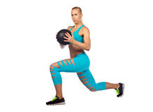 Fit woman exercise with medicine ball Royalty Free Stock Photos