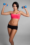 Fit Woman Exercising. Pretty fit mexican woman exercising Royalty Free Stock Image