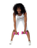 Fit woman exercising. Bending down Stock Image