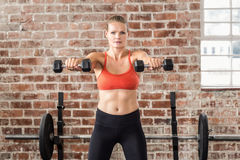 Fit woman exercising with dumbbell Royalty Free Stock Image