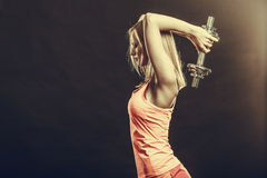 Fit woman exercising with dumbbells. Royalty Free Stock Photography