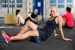 Fit Woman Exercising With Foam Roller In Health Club Stock Image