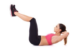 Fit woman exercising her abdominal muscles Stock Images