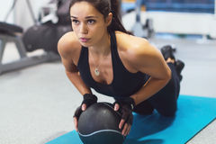 Fit woman exercising with medicine ball workout royalty free stock photography