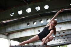 Fit woman exercising in postindustrial environment Royalty Free Stock Image