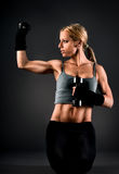 Fit woman exercising with weights Royalty Free Stock Photos