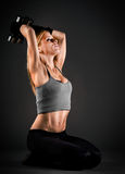 Fit woman exercising with weights Royalty Free Stock Photography