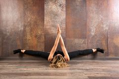 Fit woman exercising yoga on wooden floor Stock Images
