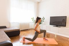 Fit young woman exsercise in the room Royalty Free Stock Photography