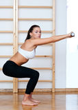 Fit woman in fitness pose Royalty Free Stock Images