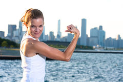 Fit woman flexing Stock Photos