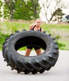 Fit Woman Flipping Tire Outdoors Royalty Free Stock Photos