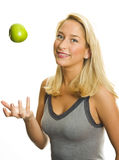 Fit woman with green apple Royalty Free Stock Photos