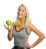 Fit woman with green apple Stock Images