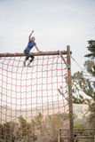 Fit woman with hand raised celebrating success during obstacle course royalty free stock image