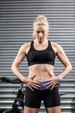 Fit woman with hands on abs Royalty Free Stock Photography