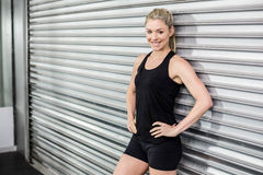 Fit woman with hands on hips Royalty Free Stock Photography