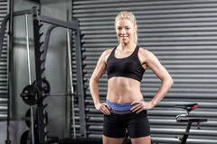 Fit woman with hands on hips Royalty Free Stock Image