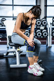 Fit woman having knees pain. At gym Stock Images