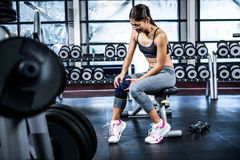 Fit woman having knees pain. At gym Stock Photo