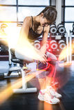 Fit woman having knees pain. At gym Royalty Free Stock Photography