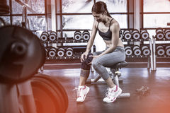 Fit woman having knees pain. At gym Royalty Free Stock Image