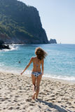 Fit woman heading towards sea on Cleopatra beach in Turkey. Full length portrait fit young young blond woman heading towards sea on Cleopatra beach in Alanya Stock Photos