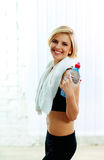 Fit woman holding a bottle with water Royalty Free Stock Photography
