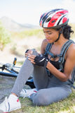 Fit woman holding her injured knee after bike crash Royalty Free Stock Image