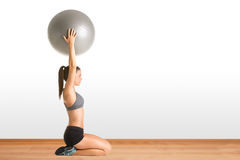 Fit Woman Holding a Pilates Ball Stock Image