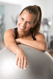 Fit Woman Holding a Pilates Ball Stock Photos