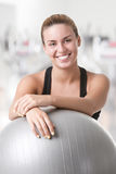 Fit Woman Holding a Pilates Ball Royalty Free Stock Photo