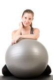 Fit Woman Holding a Pilates Ball Royalty Free Stock Photos