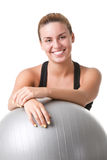 Fit Woman Holding a Pilates Ball Royalty Free Stock Images