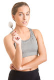 Fit Woman Holding a Spoon Stock Photo