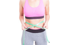 Fit woman holding tape line on waist Royalty Free Stock Photos