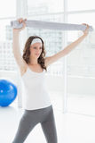 Fit woman holding up towel in a fitness studio Stock Images
