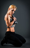 Fit woman holding weights Stock Images