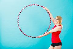 Fit woman with hula hoop doing exercise Stock Photos