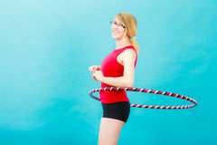 Fit woman with hula hoop doing exercise Royalty Free Stock Photo