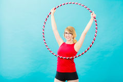 Fit woman with hula hoop doing exercise Stock Photography