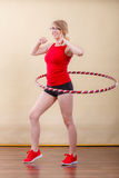 Fit woman with hula hoop doing exercise Royalty Free Stock Images